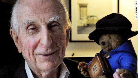 FILE - In this June 12, 2015 file photo, Michael Bond poses with a soft toy version of Paddington bear. Publisher HarperCollins says Michael Bond, creator of globe-trotting teddy Paddington bear, died on Tuesday June 27, 2017, aged 91. (Nick Ansell/PA via AP)