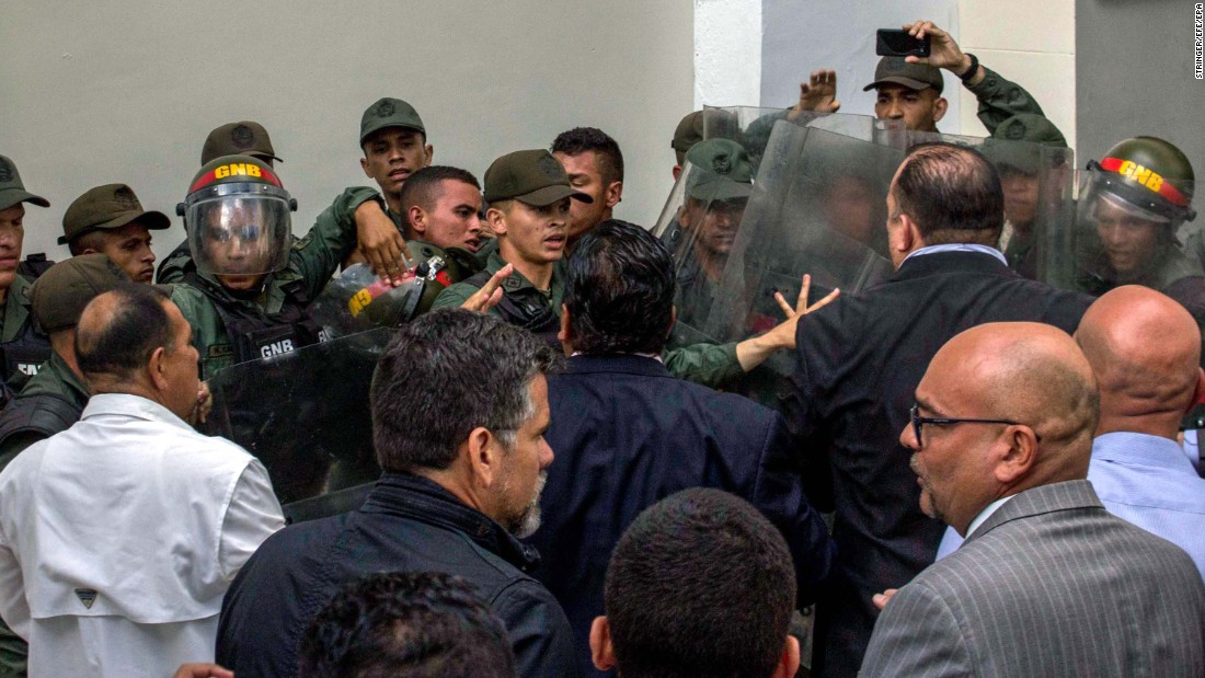 "National Guard members clash with deputies of the National Assembly in the Parliament's courtyard in Caracas on June 27. Venezuela <a href=""http://www.cnn.com/2017/05/09/americas/venezuela-violin-protester/"" target=""_blank"">has seen widespread unrest</a> since March 29, when the Supreme Court dissolved Parliament and transferred all legislative powers to itself. The decision was later reversed, but protests have continued across the country."