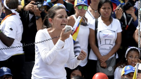 Venezuelan opposition ex-congresswoman Maria Corina Machado (C) takes part in a women's march aimed to keep pressure on President Nicolas Maduro, whose authority is being increasingly challenged by protests and deadly unrest, in Caracas on May 6, 2017. The death toll since April, when the protests intensified after Maduro's administration and the courts stepped up efforts to undermine the opposition, is at least 36 according to prosecutors.  / AFP PHOTO / FEDERICO PARRA        (Photo credit should read FEDERICO PARRA/AFP/Getty Images)
