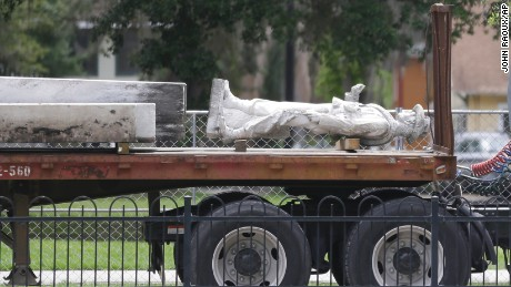"Part of Orlando's ""Johnny Reb"" statue is removed from Eola Park in June."