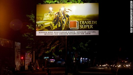 A board advertises a cigarette brand along a road in Yogyakarta, Indonesia, in 2011.