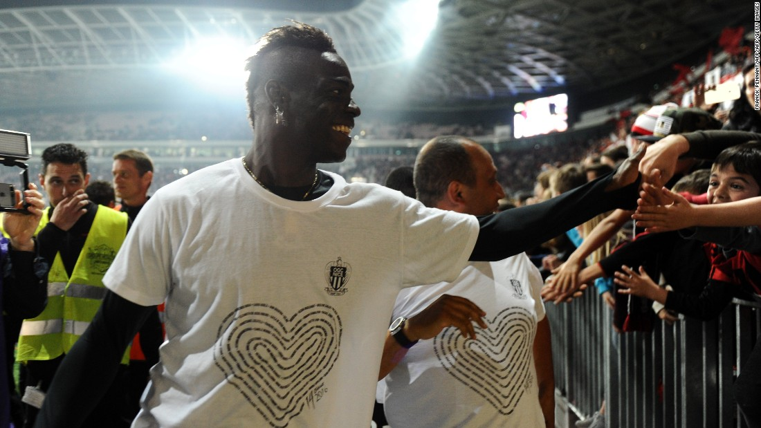 Nice forward Mario Balotelli celebrates with local supporters at the end of a French Ligue 1 football match in May. The striker dons a T-shirt which spells out the names of the 86 victims of the July 14, 2016 terror attack in the shape of a heart. The shirts were sold to raise money for the victims' families.