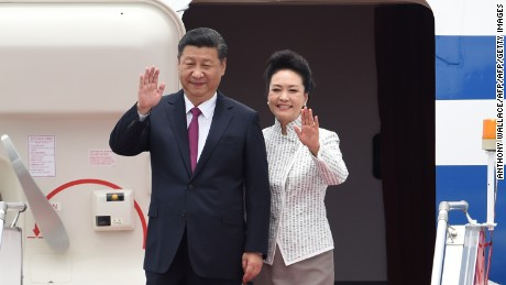 China's President Xi Jinping (L) and his wife Peng Liyuan wave upon their arrival at Hong Kong's international airport on June 29, 2017. Xi arrived in Hong Kong on June 29 to mark 20 years since it was handed back to China by Britain, with leading democracy activists already in police custody after a protest in the politically divided city. / AFP PHOTO / Anthony WALLACE        (Photo credit should read ANTHONY WALLACE/AFP/Getty Images)