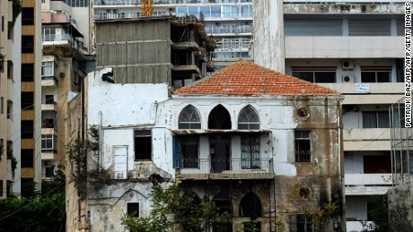 An old Lebanese house stands among modern buildings and a construction site on Beirut's Corniche on October 7, 2015.