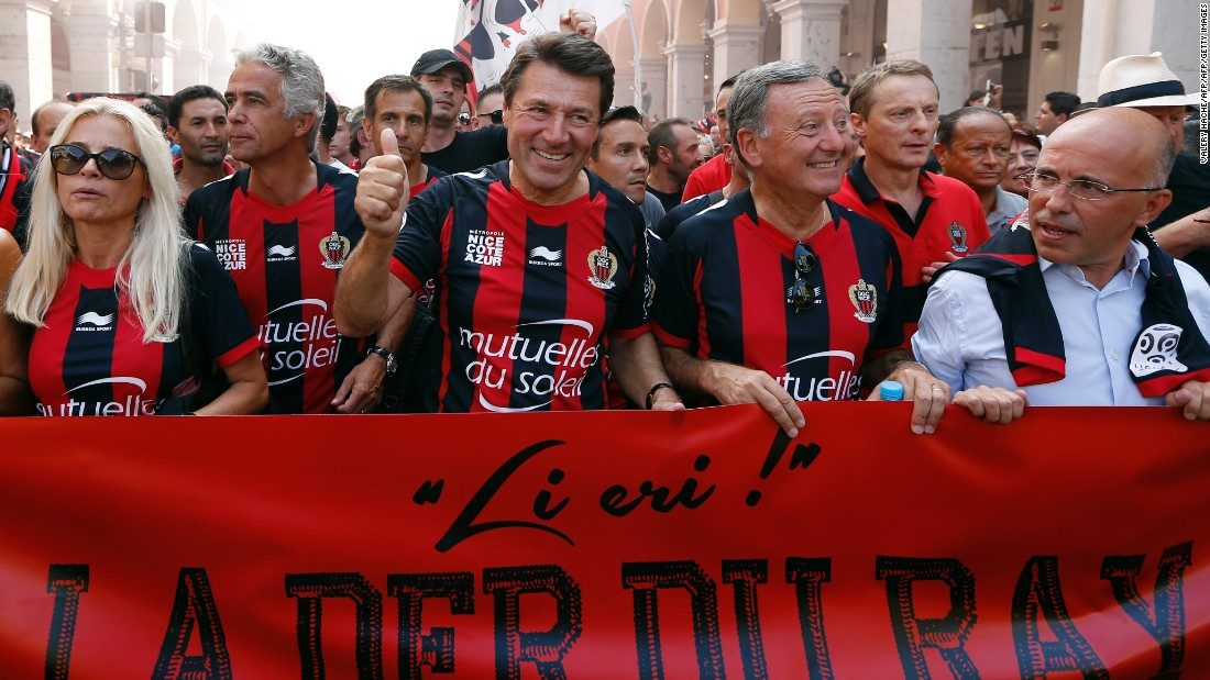 "OGC Nice president Jean-Pierre Rivère (second from left) marches with city leaders at a club rally in 2013. ""We all live in Nice, we have all been impacted directly or indirectly, and we cannot imagine that this could happen in a place like that at this moment, with children and women, it's terrible,"" Rivère told CNN."