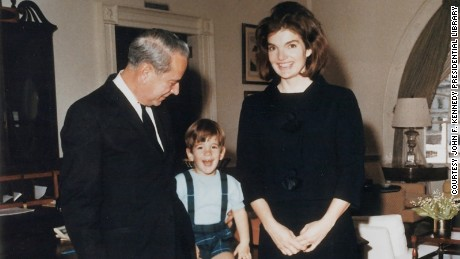 JB West, chief usher from 1957 to 1968, poses in the West Sitting Hall with Jacqueline Kennedy and John Kennedy Jr. prior to their departure from the White House following the assassination of President Kennedy.