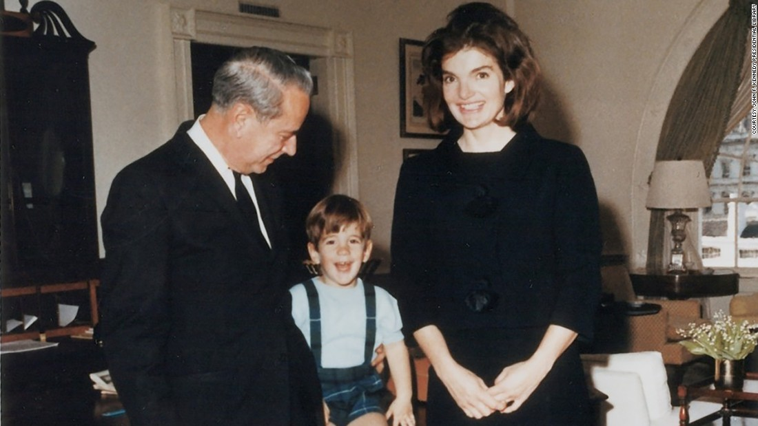 J.B. West, chief usher from 1957 to 1968, poses in the West Sitting Hall with Jacqueline Kennedy and John Kennedy Jr. prior to their departure from the White House following the assassination of President Kennedy.