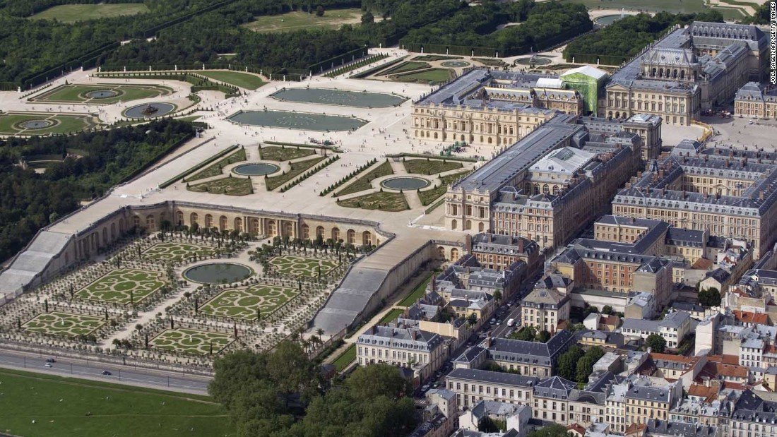 An aerial view shows Versailles and its gardens. Construction of the palace, a few miles west of Paris, began in 1661.