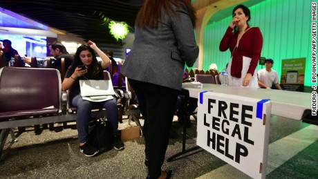 A table is setup for lawyers offering free legal advice inside the International Arrivals section at Los Angeles International Airport on June 29, 2017, where activists protested President Donald Trump's ban temporarily barring entry into the US from Libya, Iran, Somalia, Sudan, Syria and Yemen.  The ban prevents the issuance of visas to travelers from the six countries for 90 days and places the refugee-entry program on hold for 120 days. / AFP PHOTO / FREDERIC J. BROWN        (Photo credit should read FREDERIC J. BROWN/AFP/Getty Images)