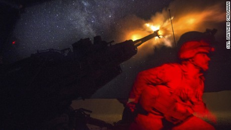 A Marine fires an M777A2 howitzer in the early morning in Syria, June 3, 2017. Marines have been conducting 24-hour all-weather fire support for the coalition's local partners, the Syrian Democratic Forces, to support Combined Joint Task Force Operation Inherent Resolve. Marine Corps photo by Sgt. Matthew Callahan