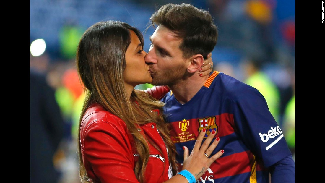 FC Barcelona's Lionel Messi kisses long-time girlfriend Antonella Roccuzzo as they celebrate Barcelona's win over Sevilla in the Copa del Rey final in Madrid in May 2016.