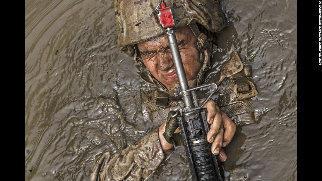 U.S. Marine candidates participate in events, such as the obstacle, endurance and combat courses, at the Officer Candidate School, Marine Corps Base Quantico, in Virginia, on June 14. Candidates must go through three months of intensive training to determine if they have the leadership, moral, mental, and physical qualities required to be a U.S. Marine Corps officer.