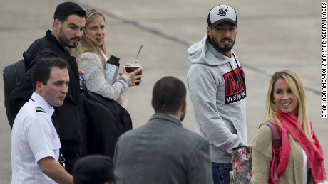 Uruguayan Luis Suarez (2-R), footballer of Spanish team Barcelona, and his wife Sofia Balbi (R) arrive at Rosario's airport, Santa Fe Province, Argentina on June 29, 2017 to attend the wedding of Argentine football star and player of Spanish Barcelona, Lionel Messi, on Friday. Football and showbiz stars started gathering in Rosario for Latin America's celebrity wedding bash of the decade when Barcelona superstar Lionel Messi marries his childhood sweetheart Antonella Roccuzzo on June 30. / AFP PHOTO / Eitan ABRAMOVICH        (Photo credit should read EITAN ABRAMOVICH/AFP/Getty Images)
