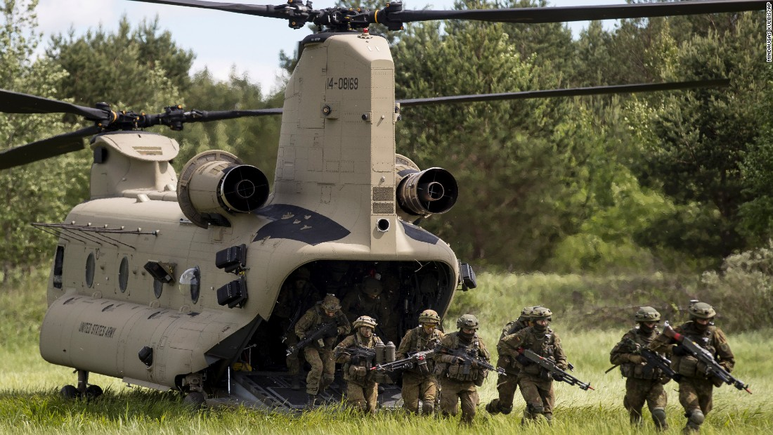 Soldiers aboard a U.S. Air Force CH-47 Chinook helicopter take part in the NATO military exercise 'Iron Wolf 2017' at a training range in Pabrade, Lithuania on June 22. The exercise, being held in different parts of Lithuania, will involve roughly 5,000 participants from Lithuania and nine other NATO allies.