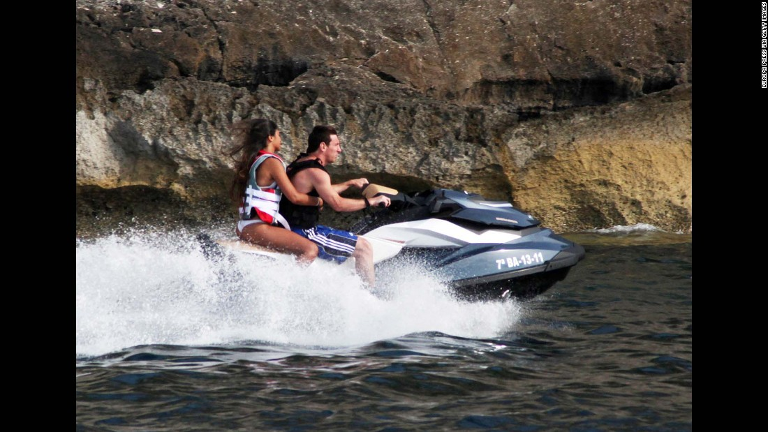 Messi and Roccuzzo ride a jet ski in Ibiza, Spain, in August 2011.