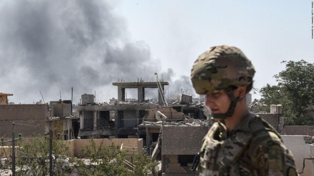A US soldier advising Iraqi forces is seen in the city of Mosul during the ongoing offensive by Iraqi troops to retake the last district still held by the Islamic State (IS) group.