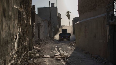 An Iraqi special forces humvee rides through the Old City on June 29.