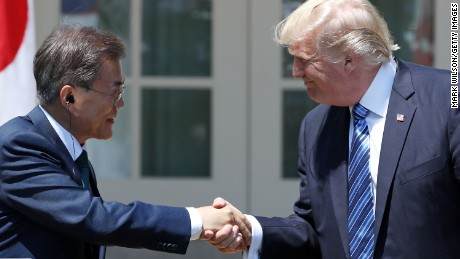 WASHINGTON, DC - JUNE 30:  U.S. President Donald Trump (R) and South Korean President Moon Jae-in shake hands while delivering joint statements in the Rose Garden of the White House on June 30, 2017 in Washington, DC. President Moon is on a three-day visit in Washington. He had an Oval Office meeting with President Trump prior to joint statements.  (Photo by Mark Wilson/Getty Images)