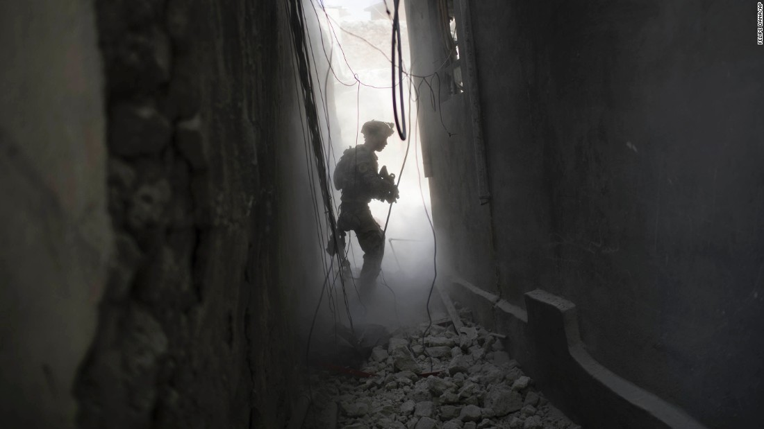 An Iraqi Special Forces soldier exchanges fire with ISIS militants in the Old City of Mosul on Friday, June 30.