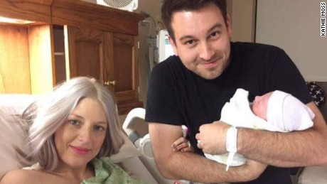 Nathan Johnson holds his new daughter, Eilee Kate, with his wife.