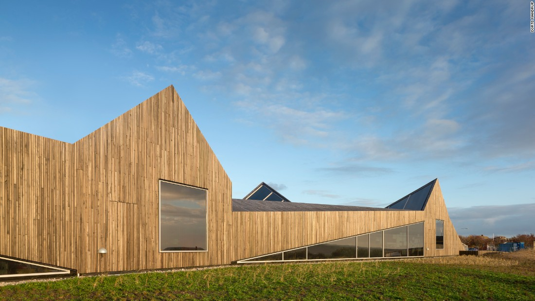 "This Mandrup building was designed to become ""part of the landscape"". Located in a small fishing village outside Helsingborg in Sweden, this has an entirely wooden surface, while its form imitates both the neighboring sand dunes and nearby small fishermen houses."
