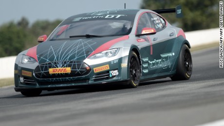 The Tesla Electric GT car drives during a demonstration on April 27, 2017 on the Pau-Arnos circuit  in Pau, southwestern France. / AFP PHOTO / IROZ GAIZKA        (Photo credit should read IROZ GAIZKA/AFP/Getty Images)