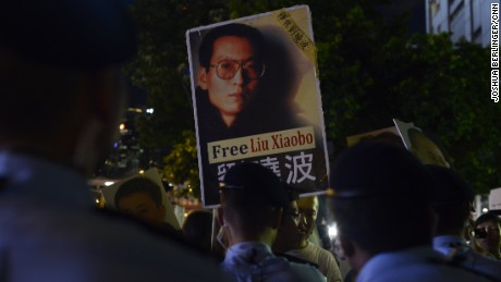 A protester holds up a picture of Chinese dissident Liu Xiaobo on June 30, 2017, in Hong Kong.