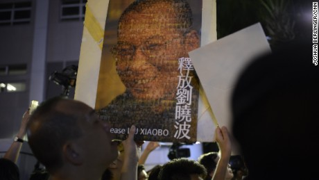 A protester holds up a picture of Chinese dissident LIu XIaobo in Hong Kong on Friday, June 30.