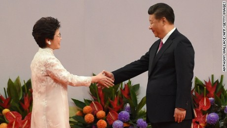 Hong Kong's new Chief Executive Carrie Lam (L) shakes hands with China's President Xi Jinping (R) after being sworn in as the territory's new leader at the Hong Kong Convention and Exhibition Centre in Hong Kong on July 1, 2017. Lam became Hong Kong's new leader on July 1, which marks the culmination of the lifelong civil servant's career as she inherits a divided city fearful of China's encroaching influence.  / AFP PHOTO / Anthony WALLACE        (Photo credit should read ANTHONY WALLACE/AFP/Getty Images)