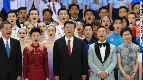 """China's President Xi Jinping sings a song entitled """"My Country"""" at the end of a gala event in Hong Kong on June 30, 2017."""