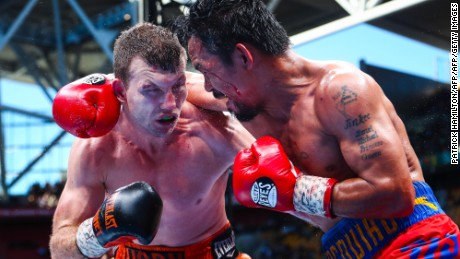 Manny Pacquiao (R) of the Philippines fights Jeff Horn (L) of Australia during the World Boxing Organization boat at Suncorp Stadium in Brisbane on July 1, 2017.