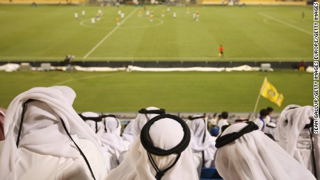 DOHA, QATAR - OCTOBER 23:  Fans wearing traditional local dress attend the Gharafa vs. Kharaitiyat Qatar Stars League football match at Al Gharafa Stadium on October 23, 2011 in Doha, Qatar. Qatar will host the 2022 FIFA World Cup football competition and is slated to tackle a variety of infrastructure projects, including the construction of new stadiums.  (Photo by Sean Gallup/Getty Images)