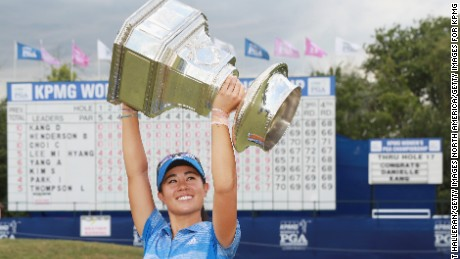 OLYMPIA FIELDS, IL - JULY 02:  Danielle Kang poses with the trophy after winning the 2017 KPMG Women's PGA Championship at Olympia Fields Country Club on July 2, 2017 in Olympia Fields, Illinois.  (Photo by Scott Halleran/Getty Images for KPMG)