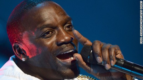 (FILES) This file photo taken on June 3, 2015 shows Senegalese-American rapper Akon performing during the 14th edition of the Mawazine music festival in Rabat.  Cliched rappers spend money on bling and cars, but Senegalese-American artist Akon is looking skywards to splash his cash, investing in solar power projects across Africa. The rapper added The Gambia and Cape Verde to his Akon Lighting Africa initiative on March 4, 2017, a fund that already helps populations who struggle to connect to limited or absent national grids in 25 African countries. / AFP PHOTO / FADEL SENNAFADEL SENNA/AFP/Getty Images