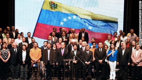 The president of the Venezuelan National Assembly Julio Borges (C, left) is pictured during a meeting with different sectors of the civil society in which he called for unity and announced the opposition would stage its own popular vote against  the plan by President Nicolas Maduro to form an assembly to reform the constitution, at the theatre of Chacao in Caracas, on July 3, 2017. Venezuela's opposition called for a popular vote on July 16 over Maduro's constitutional reforms which it brands a ploy to cling to power. A political and economic crisis in the oil-producing country has spawned often violent demonstrations by protesters demanding Maduro's resignation and new elections. The unrest has left 89 people dead since April 1. / AFP PHOTO / Juan BARRETO        (Photo credit should read JUAN BARRETO/AFP/Getty Images)