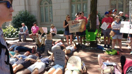"Health care protesters hold ""die in"" protest outside Sen. Pat Toomey's office in Philadelphia, Pennsylvania."