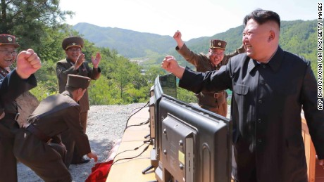 "This picture taken and released on July 4, 2017 by North Korea's official Korean Central News Agency (KCNA) shows North Korean leader Kim Jong-Un (R) reacting after the test-fire of the intercontinental ballistic missile Hwasong-14 at an undisclosed location. North Korea declared on July 4 it had successfully tested its first intercontinental ballistic missile -- a watershed moment in its push to develop a nuclear weapon capable of hitting the mainland United States. / AFP PHOTO / KCNA VIA KNS / STR / South Korea OUT / REPUBLIC OF KOREA OUT   ---EDITORS NOTE--- RESTRICTED TO EDITORIAL USE - MANDATORY CREDIT ""AFP PHOTO/KCNA VIA KNS"" - NO MARKETING NO ADVERTISING CAMPAIGNS - DISTRIBUTED AS A SERVICE TO CLIENTS THIS PICTURE WAS MADE AVAILABLE BY A THIRD PARTY. AFP CAN NOT INDEPENDENTLY VERIFY THE AUTHENTICITY, LOCATION, DATE AND CONTENT OF THIS IMAGE. THIS PHOTO IS DISTRIBUTED EXACTLY AS RECEIVED BY AFP.   / STR/AFP/Getty Images"