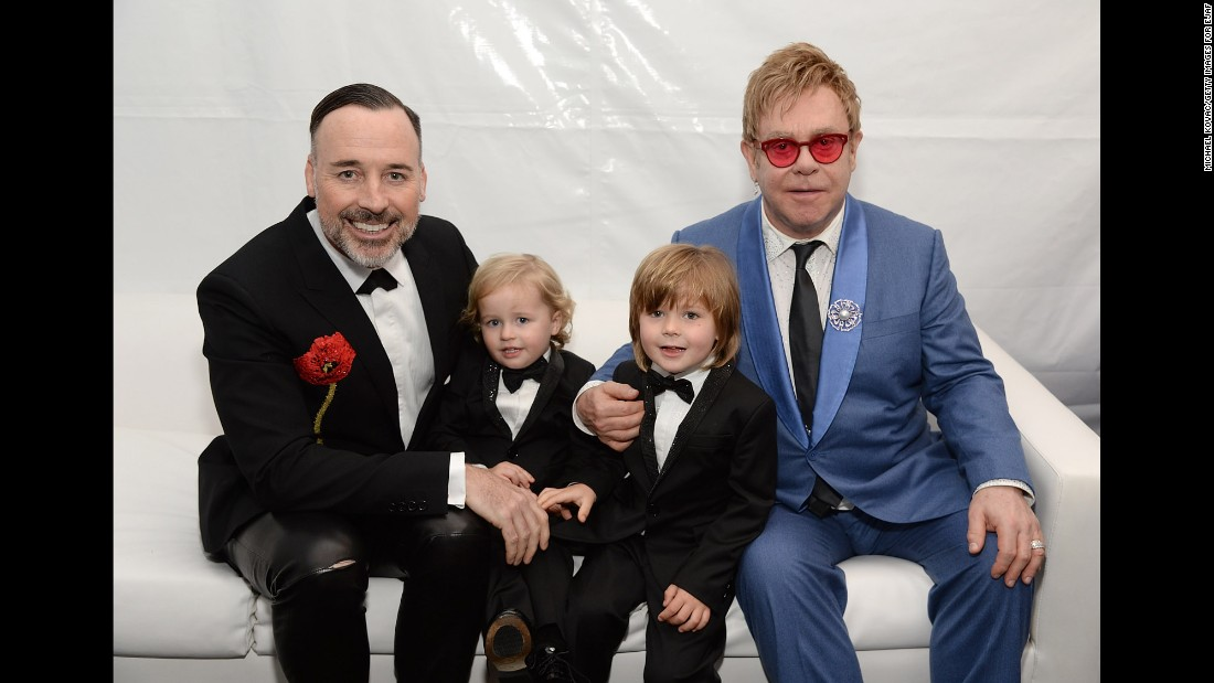 John, Furnish and their two boys pose for a photo in 2015.