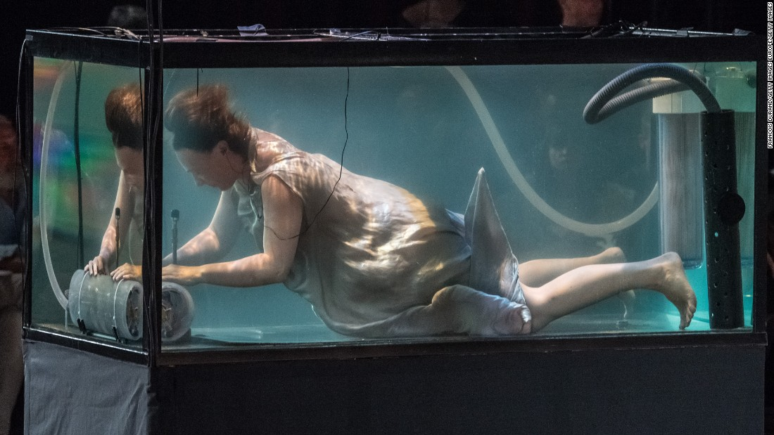 Continuing in the extravagant and avant garde traditions of couture week, models on the Iris Van Herpen runway were accompanied by musicians playing underwater.