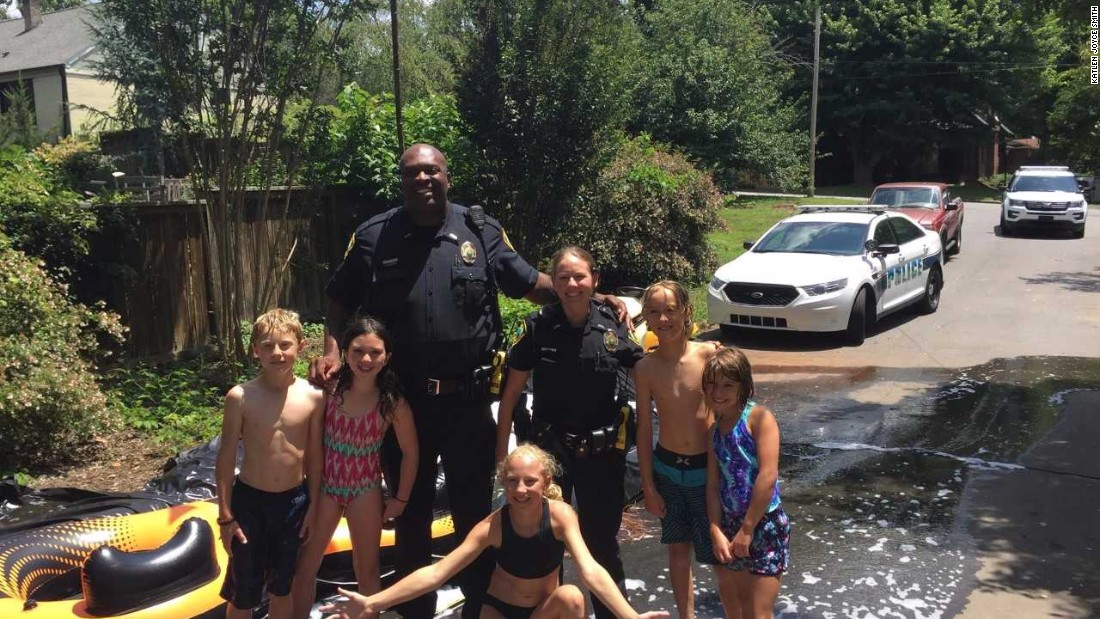 Cops get complaint about slip-and-slide, end up going on it