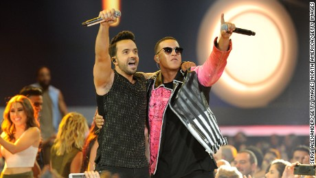 "Luis Fonsi, left, and Daddy Yankee perform the hit song ""Despacito"" at the Billboard Latin Music Awards in April."