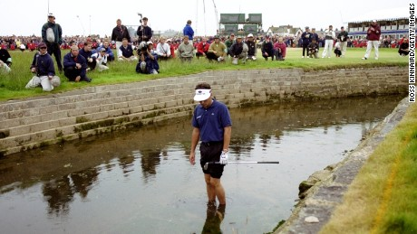Frenchman Jean Van de Velde looks at his ball in the burn on the 18th hole during the 1999 British Open at Carnoustie.