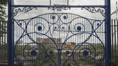 Wrought iron gates guard the entrance to Silvertown. The area is named after Samuel Winkworth Silver, who opened a waterproof clothing factory there in 1852.