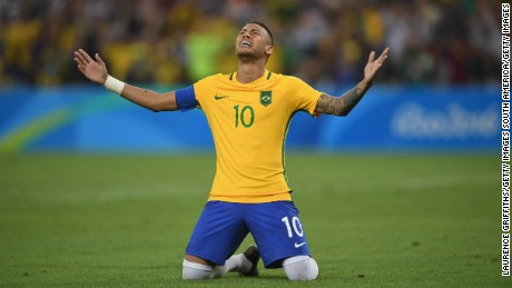 Neymar celebrates scoring the winning penalty in the penalty shoot out during the men's Olympic final between Brazil and Germany at the Maracana Stadium