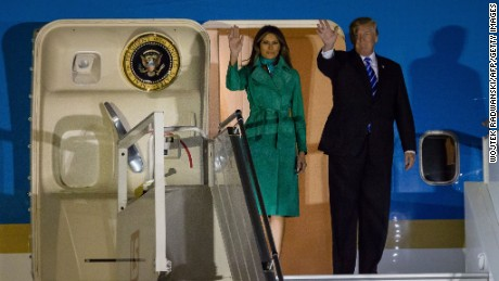 US President Donald Trump (R) and US First Lady Melania Trump (L) step off Air Force One upon their arrival at Chopin Airport in Warsaw,on July 5, 2017. Donald Trump arrived for high-stakes visit to Europe on July 5, landing in Poland ahead of his first G20 summit in Hamburg and a closely-watched meeting with Russian President Vladimir Putin. (WOJTEK RADWANSKI/AFP/Getty Images)