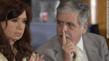 Argentina's President Cristina Fernandez de Kirchner (L) speaks with Argentinian Minister of Planning and Public Investment Julio de Vido during a ceremony for the160th anniversary of Buenos Aires Stock Exchange in Buenos Aires on August 20, 2014. AFP PHOTO / JUAN MABROMATA        (Photo credit should read JUAN MABROMATA/AFP/Getty Images)