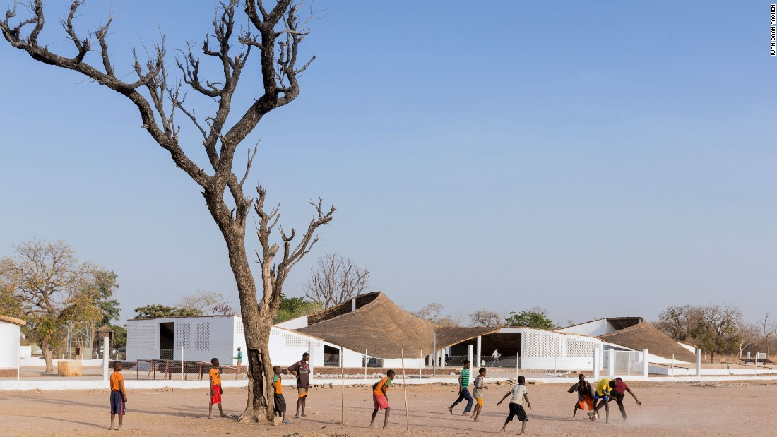 The artists' residency blends into its surroundings in Sinthian, a small Senegalese village. While bricks were used for the walls, local earth and thatch were used for the sloping roof that moves like a wave over the building.