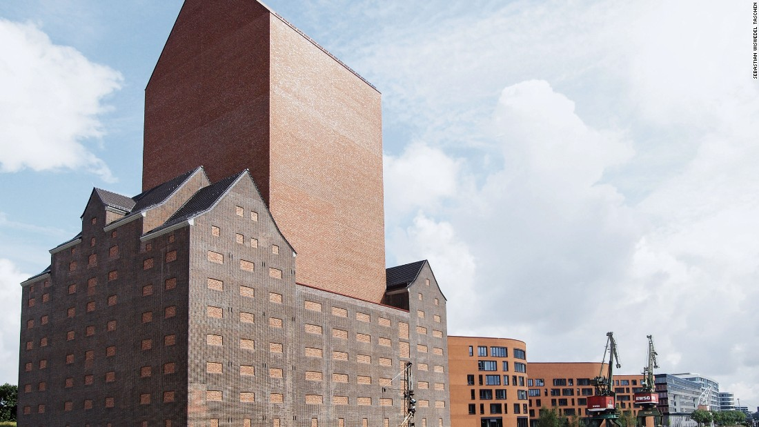 The tower of the state archive of North Rhine Westphalia rises 249 feet out of a historic brick warehouse.