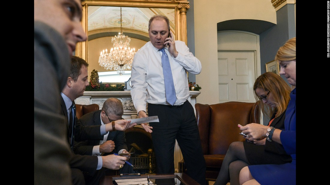 "Scalise meets with staff members while checking a vote count in Washington in December 2014. <a href=""http://www.cnn.com/2017/06/14/politics/who-is-steve-scalise/index.html"" target=""_blank"">As House majority whip,</a> Scalise is tasked with tracking other Republican members and ensuring there are enough votes to win approval of key priorities."