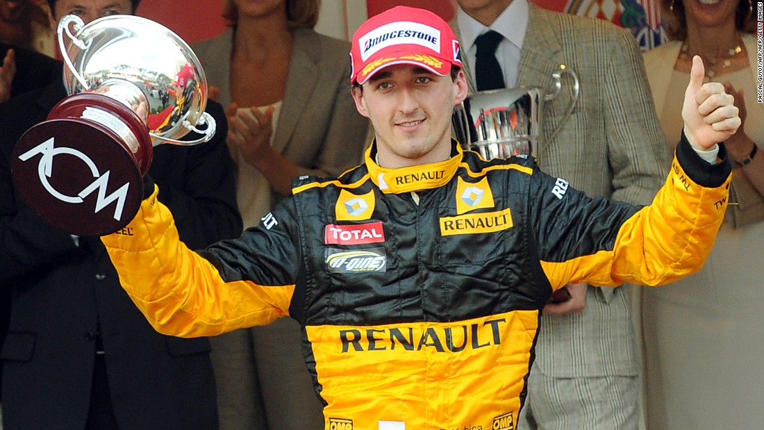 Kubica celebrates third place at the Monaco Grand Prix in 2010.